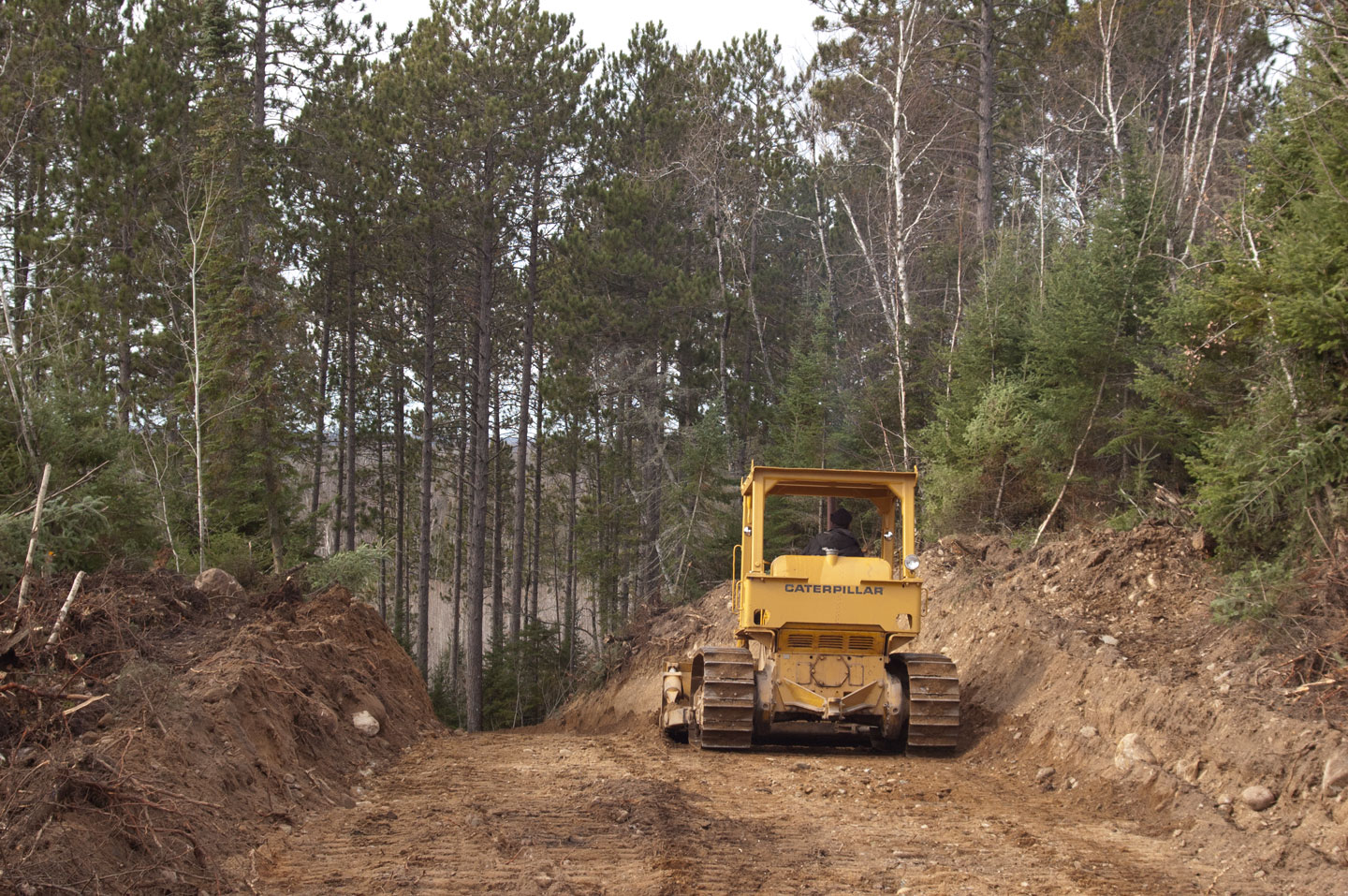Brian Trancheff operates his bulldozer cutting the new section of the Rolley Spur of the iron Ore trails connecting Lake Vermilion to state trails.