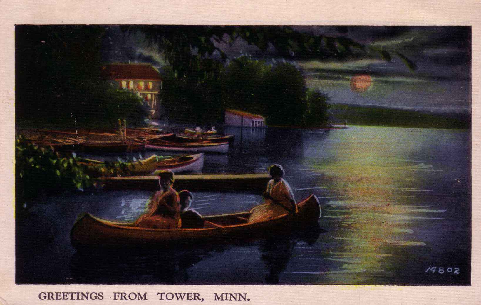 Three people enjoy a moonlit paddle on Lake Vermilion in this 1939 full-color linen postcard.