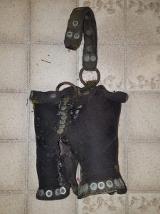 Leather bucket found near the former Tower & Soudan Street Railway track.